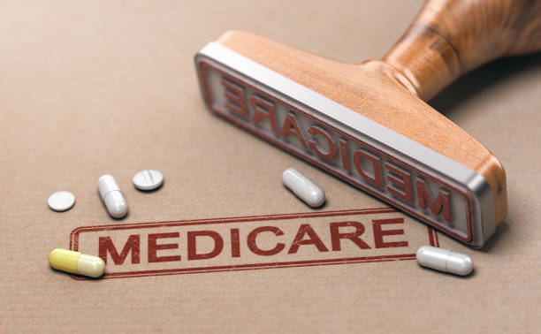 3D illustration of a rubber stamp with the text medicare and pills over paper background.